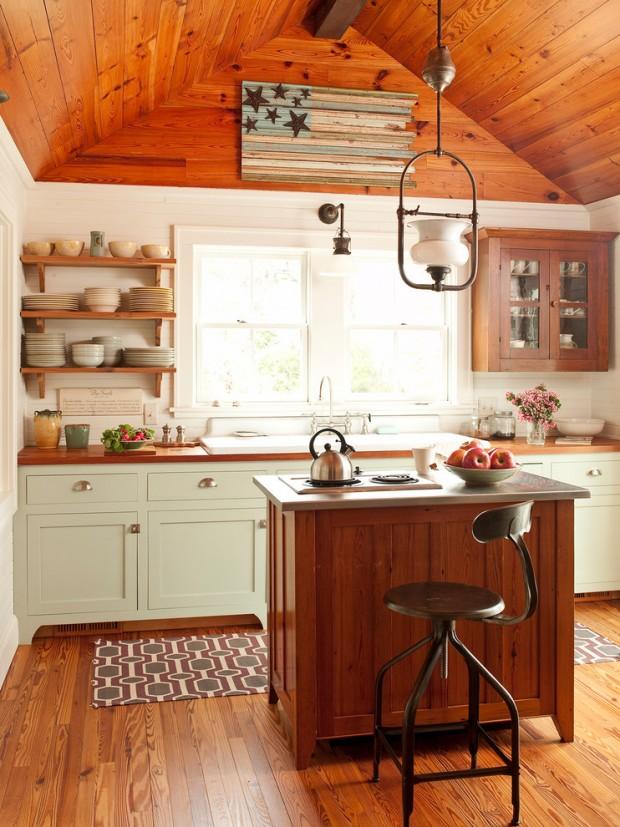 На фото: простой, но стильный деревянный интерьер не больной кухни
