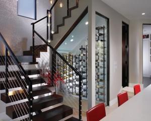 Фото: винный шкаф под лестницей