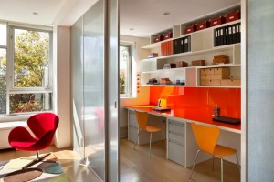 Sleek-desks-and-sliding-glass-doors-make-this-the-perfect-study-space-for-kids