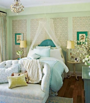 Turquoise-bedding-in-green-bedroom-with-vintage-motive-wallpaper-combined-with-classic-marble-top-table-side-on-wooden-floor-915x10531