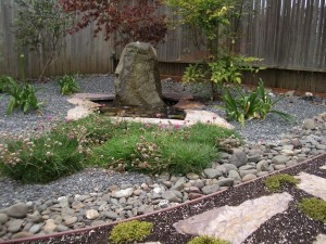 Lovely-use-of-stone-and-still-water-in-this-home-Japanese-garden