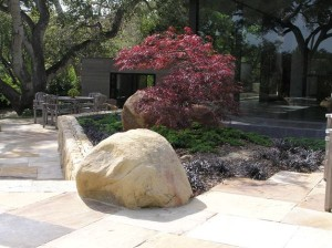Simple-garden-space-with-a-fine-balance-of-rock-stone-and-a-touch-of-Japanese-maple