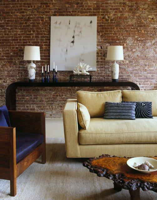Кирпичная стена в оформлении гостиной в стиле модерн