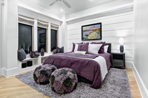 Lovely-blend-of-various-shades-of-purple-and-violet-set-against-grey-walls-in-the-bedroom