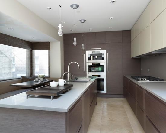 зональное разделение пространства в кухне серого цвета при помощи освещения
