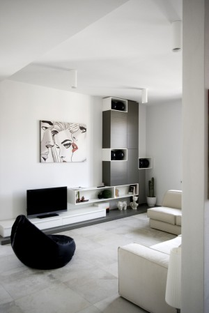Black-And-White-Painting-Hanging-On-White-Wall-Above-Screen-Flat-TV1