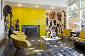 Colorful-living-room-displays-a-wonderful-collection-of-African-statues-and-artifacts
