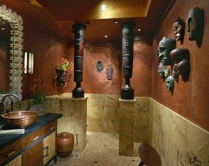 Pacific-Island-masks-along-with-a-pair-of-African-drums-in-the-powder-room