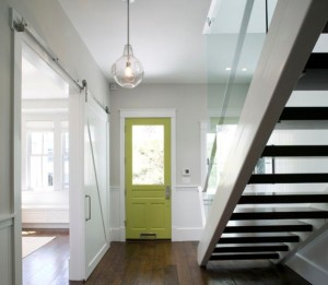 Add-drama-to-the-entry-way-with-a-green-door-set-in-a-neutral-background