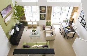 Drapes-and-couch-in-accent-wall-color-highlight-the-light-moss-green-in-the-living-space