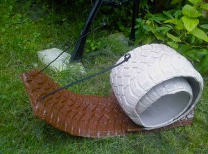 used-tires-recycling-brown-snail-idea-plastic-tie-strap-antena-garden-tire-decoration