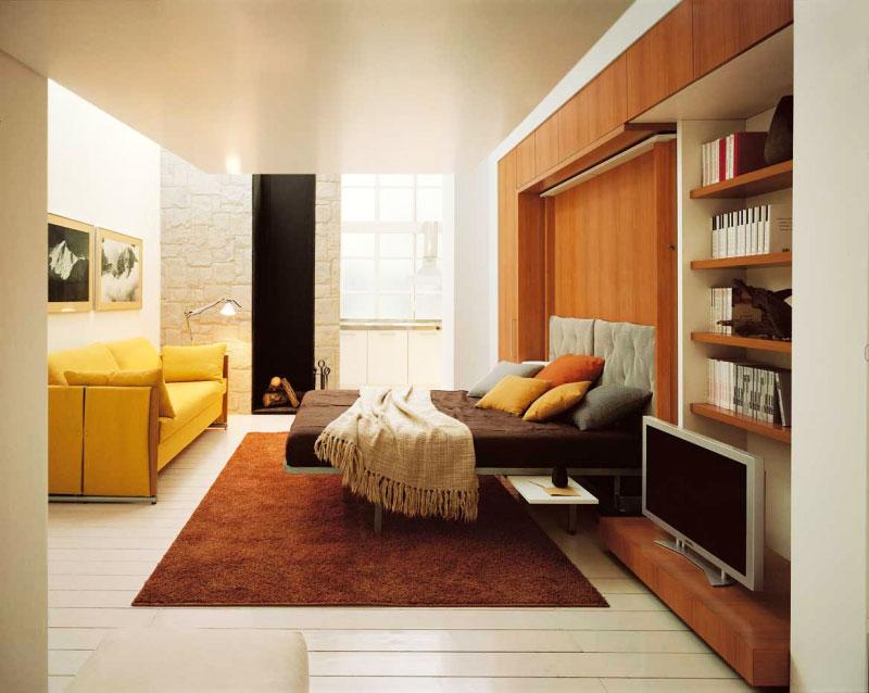 Дизайн спальни с диваном и кроваткой