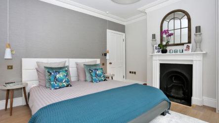 Дизайн спальни с камином